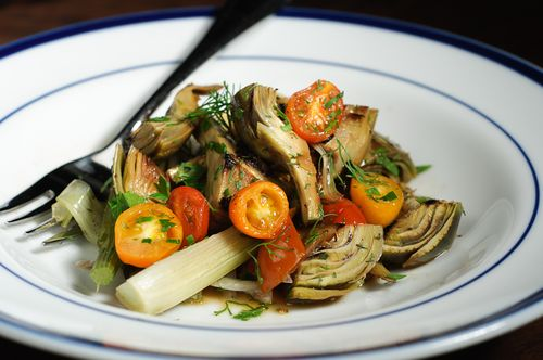Braised baby artichokes with fennel and cherry tomatoes